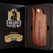 The Sandalwood Switchblade is our take on a classic 19th century foldable beard comb. This handcrafted artisan comb is perfect accompaniment for beards, mustaches and hair. Each beard comb is a unique work of art. From a unique piece of fragrant sandalwood each comb is carefully cut, sand, fitted, resanded, polished, and laser-etched. Our skilled craftsmen assemble three individual pieces of fragrant sandalwood to make each beard comb, and it is a painstaking process. Sandalwood is the 2nd most expensive wood in the world, due to its permanent fragrant nature, strength and aesthetic appeal, all of which has been valued since ancient times. Our combs are extremely smooth, pleasing to the touch, and are a testament to beautiful wood. The foldable design of our beard comb provides an ergonomic yet aggressive and masculine design element. We also offer a genuine leather engraved pouch that is as attractive as it is protective; it is a smart accessory to buy in order to protect you comb. This foldable wooden switchblade comb can be stored easily in the pocket of one's jeans or coat, and makes the perfect companion for our Beard's Beard Oil or Old-Fashioned Beard Balm. In contrast to a plastic, bone or metal comb, a sandalwood comb lightly absorbs some of the surface oil and thus has better traction and hold when combing well groomed and oiled beard hair. Plus, the sandalwood comb just smells great and leaves a little bit of that fragrance behind.