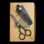 "A great set of trimming scissors is a necessity: for this reason Beard & Bates has designed, developed and hand-crafted some of the best shears money can buy. Our 1878 Black Label Shears were inspired by classic 19th Century grooming scissors which were prized possessions carried by cavalry commanders who favored long and intimidating facial hair. Taking a cue from the fact that Cavalry soldiers' tools of the trade were carbines, pistols and sabers, we created a unique embossed genuine leather holster/scabbard to complement these fine shears. The best modern steel is Japanese, and the1878 Black Label Shears are crafted from the finest J2 420 Japanese steel and heat treated to Rockwell Hardness of 55-56. The scissors are 4.5"" in total, currently TSA approved for travel, and the blades are razor sharp convex edge blades, which are hollow ground to make precision cuts, and require no resharpening. This quality level is on par with profession hair cutting scissors which cost $250-$500. The traditional ergonomic design enables you to put your ring finger through the hole, use the two indentations to rest your index and middle fingers, all while allowing your pinky to sit atop the brass finger rest. This provides one much more fluid control when trimming. It had become historically common for Calvary forces to wear imposing facial hair, whether it be long mustaches or full beards, so as to appear more imposing to the enemy, and so specific appearance was an important ""weapon."" Weapon or not, your facial hair will benefit from this quality holstered set of shears."
